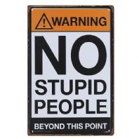A metal warning sign with 'No stupid people beyond this point' ..